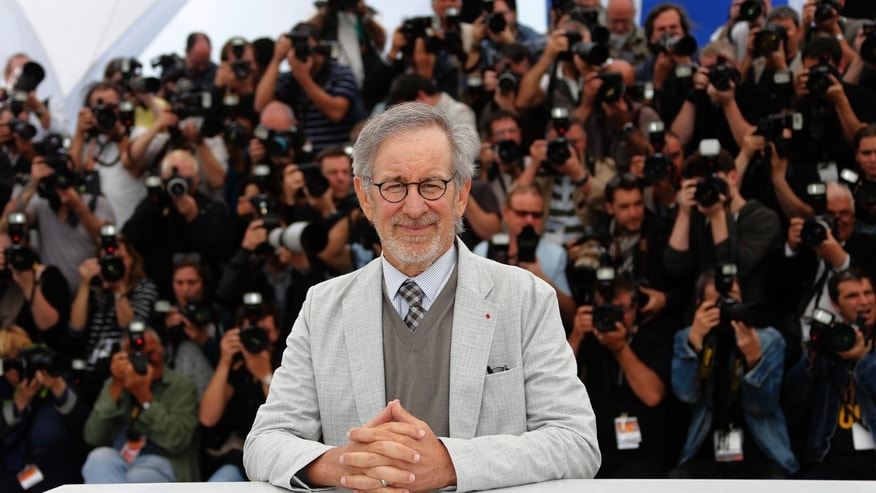 "Director Steven Spielberg meets with Harrison Ford at an ""Indiana Jones"" promotion event"