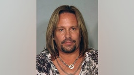 Motley Crue singer Vince Neil is seen in this police booking mug shot from the Las Vegas Police Department, released to Reuters June 28, 2010. Neil has been arrested on suspicion of drunk driving and was being held in a Las Vegas jail, police said on Monday.   REUTERS/Las Vegas Police Department/Handout   (UNITED STATES - Tags: ENTERTAINMENT CRIME LAW HEADSHOT) FOR EDITORIAL USE ONLY. NOT FOR SALE FOR MARKETING OR ADVERTISING CAMPAIGNS