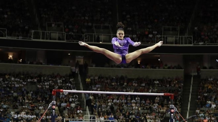 Lauren Hernandez competes on the uneven bars during the women's U.S. Olympic gymnastics trials in San Jose, Calif., Friday, July 8, 2016. (AP Photo/Gregory Bull)