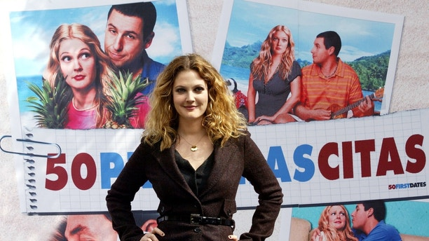 U.S. actress Drew Barrymore poses for photographers during the presentation of Peter Segal's film '50 First Dates' in a central hotel in Madrid, April 21, 2004. [The premier of the movie staring Barrymore and Adam Sandler will be on April 23.] - RTXMKH7