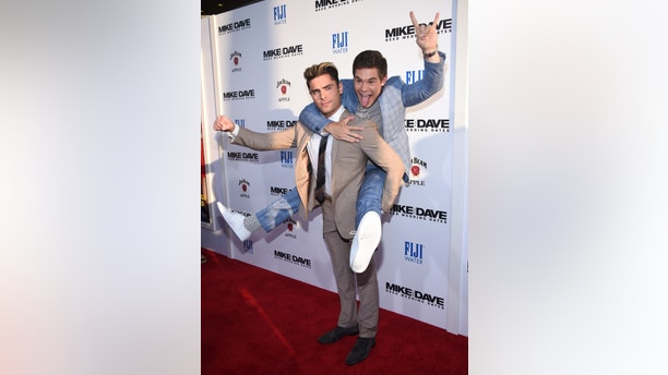"""Cast members Zac Efron and Adam Devine attend the premiere of """"Mike and Dave Need Wedding Dates"""" in Hollywood, California, U.S. June 29, 2016.  REUTERS/Phil McCarten - RTX2IYMF"""