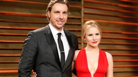 Actress Kristen Bell and her husband, actor Dax Shepard, arrive at the 2014 Vanity Fair Oscars Party in West Hollywood, California March 2, 2014. REUTERS/Danny Moloshok (UNITED STATES TAGS: ENTERTAINMENT) (OSCARS-PARTIES) - RTR3FYVL