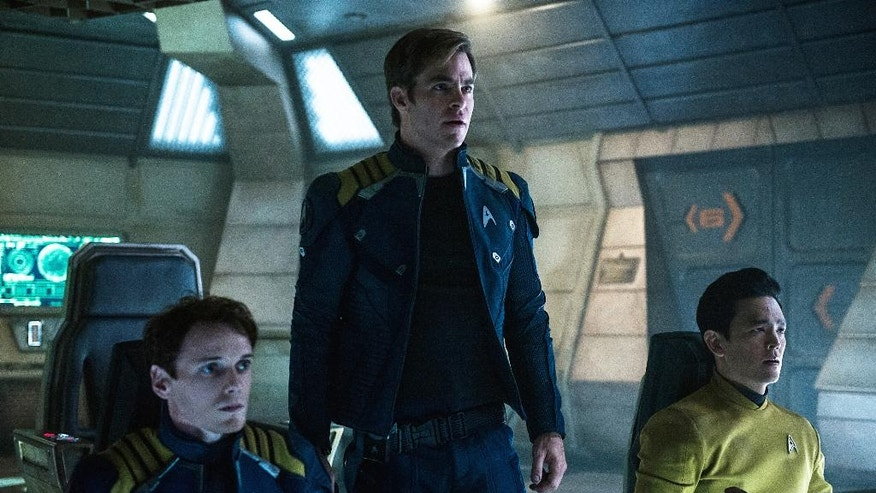 "In this image released by Paramount Pictures, from left, Anton Yelchin, Chris Pine and John Cho appear in a scene from, ""Star Trek Beyond."" (Kimberley French/Paramount Pictures via AP)"