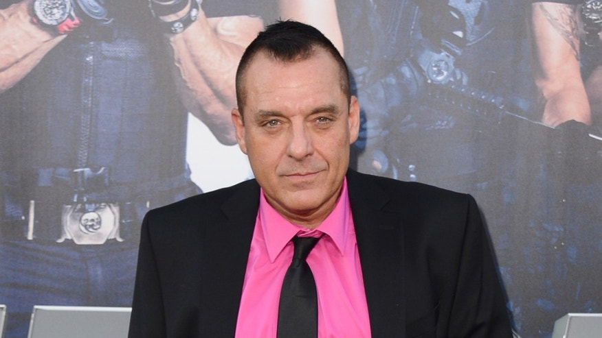 """FILE - In this Aug. 11, 2014 file photo, actor Tom Sizemore arrives at the premiere of """"The Expendables 3"""" in Los Angeles. Los Angeles police arrested Sizemore on suspicion of domestic violence Tuesday, July 19, 2016 after receiving a call around 8:15 a.m. about a fight involving the actor in downtown Los Angeles. (Photo by Jordan Strauss/Invision/AP, File)"""