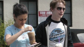 Macaulay Culkin, fresh off his testimony at the Michael Jackson trial, strolled with fiance Mila Kunis in West Hollywood.  The pair sipped iced coffees.  May 13, 2005.  EXCLUSIVE X17agency.com