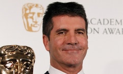 Television mogul Simon Cowell poses after receiving the British Academy Television Awards Special Award at the Palladium Theatre in London June 6, 2010.  REUTERS/Luke MacGregor (BRITAIN - Tags: ENTERTAINMENT PROFILE SOCIETY)