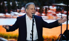 Singer-Songwriter Paul Simon sings during the first day of the Democratic National Convention in Philadelphia , Monday, July 25, 2016. (AP Photo/J. Scott Applewhite)