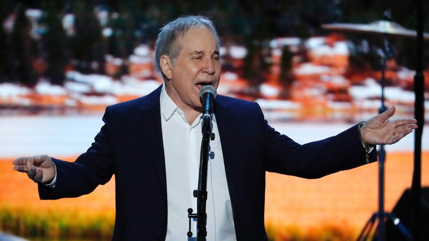 Singer-Songwriter Paul Simon sings during the first day of the Democratic National Convention in Philadelphia , Monday, July 25, 2016.