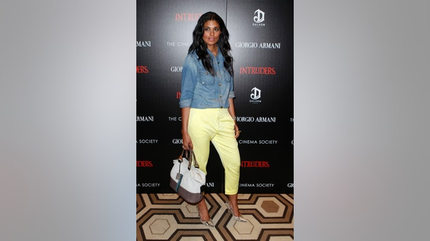 "Designer Rachel Roy arrives for a Cinema Society screening of the film ""Intruders"" in New York March 19, 2012.  REUTERS/Lucas Jackson (UNITED STATES - Tags: ENTERTAINMENT) - RTR2ZLHZ"