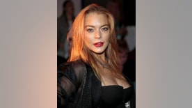 Actress Lindsay Lohan arrives for the presentation of the  Gareth Pugh Spring/Summer 2016 collection during London Fashion Week in London, Britain September 19, 2015. REUTERS/Suzanne Plunkett - RTS1X1J