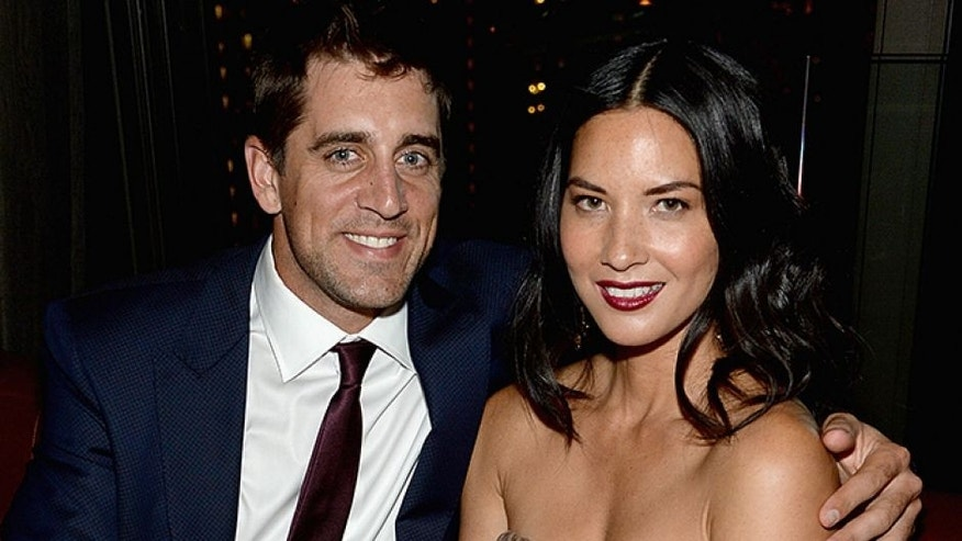 "NEW YORK, NY - JUNE 24: Aaron Rodgers and Olivia Munn attend the ""Deliver Us From Evil"" screening after party hosted by Screen Gems & Jerry Bruckheimer Films with The Cinema Society at The Skylark on June 24, 2014 in New York City. (Photo by Jamie McCarthy/WireImage)"