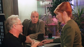 """FILE- In this Feb. 5, 1997, file photo, director Tony Dow, left, talks with """"Babylon 5"""" actors, Jerry Doyle, middle, and Patricia Tallman, during a rehearsal at the syndicated television show's studio in Los Angeles. Doyle, actor and nationally syndicated conservative talk show host, was found dead, Wednesday, July 27, 2016, in his Las Vegas home. He was 60. Doyle was best-known for his role as Michael Garibaldi in the 1990s science-fiction show """"Babylon 5.""""  (AP Photo/Jerry Henkel, File)"""