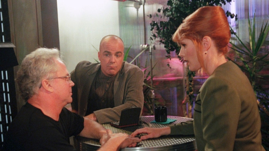 "FILE- In this Feb. 5, 1997, file photo, director Tony Dow, left, talks with ""Babylon 5"" actors, Jerry Doyle, middle, and Patricia Tallman, during a rehearsal at the syndicated television show's studio in Los Angeles. Doyle, actor and nationally syndicated conservative talk show host, was found dead, Wednesday, July 27, 2016, in his Las Vegas home. He was 60. Doyle was best-known for his role as Michael Garibaldi in the 1990s science-fiction show ""Babylon 5.""  (AP Photo/Jerry Henkel, File)"