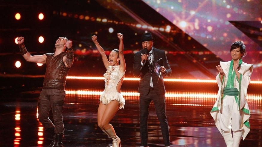 "AMERICA'S GOT TALENT -- ""Live Results 1""  Episode: 1113 -- Pictured: (l-r) Deadly Games, Nick Cannon, Hara -- (Photo by: Trae Patton/NBC)"