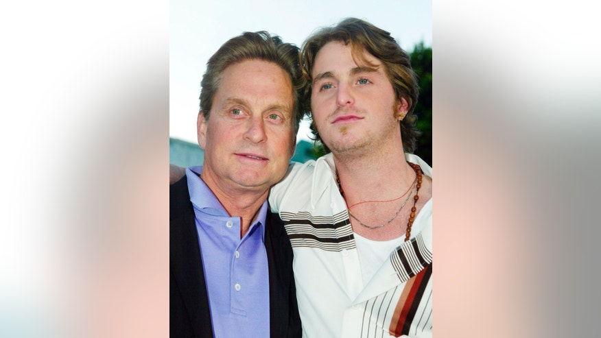 "Actor Michael Douglas (L) and his son Cameron pose as they arrive for the premiere of their new film ""It Runs In The Family"" in this file photo taken in Los Angeles, California, April 7, 2003."