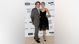 FILE - In this April 25, 2015, file photo, Robert Herjavec, left, and Kym Johnson arrive at the 4th Annual Reel Stories, Real Lives Benefit held at Milk Studios in Los Angeles. People magazine reported July 31, 2016, that the reality stars married in Los Angeles. (Photo by Richard Shotwell/Invision/AP, File)