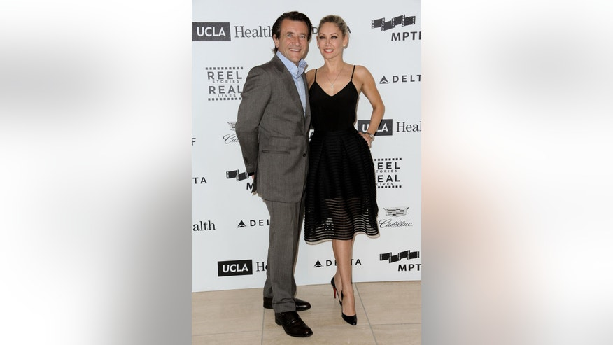 In this April 25, 2015, file photo, Robert Herjavec, left, and Kym Johnson arrive at the 4th Annual Reel Stories, Real Lives Benefit held at Milk Studios in Los Angeles.