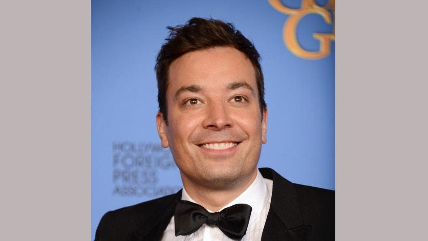 FILE - In this Jan. 12, 2014 file photo, Jimmy Fallon poses in the press room at the 71st annual Golden Globe Awards in Beverly Hills, Calif. Fallon will host the 74th annual Golden Globe Awards, Sunday, Jan. 8, 2017. (Photo by Jordan Strauss/Invision/AP, File)