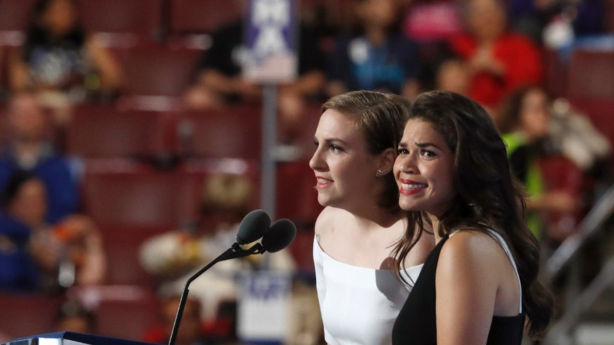 Actresses America Ferrera, right, and Lena Dunham speak during the second day of the Democratic National Convention in Philadelphia , Tuesday, July 26, 2016. (AP Photo/Paul Sancya)