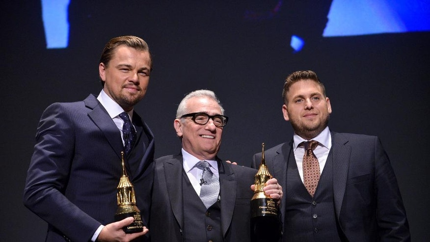 In this Feb, 6, 2014, file photo, Leonardo DiCaprio, Martin Scorsese, and Jonah Hill are seen onstage at 2014 Santa Barbara International Film Festival - Cinema Vanguard Award ceremony in Santa Barbara, Calif.