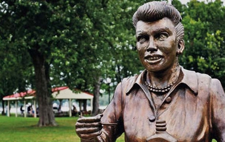 "FILE - In this Aug. 2012 photo, a bronze sculpture of Lucille Ball is displayed in Lucille Ball Memorial Park in the village of Celoron, N.Y. A new statue of Ball is being unveiled Saturday, Aug. 6, 2016, in the late actress' hometown to replace this one that was so hated it was dubbed ""Scary Lucy."" Sculptor Carolyn Palmer hopes her tribute will please fans who demanded that another artist's unflattering version be banished. (The Post-Journal via AP, File)"