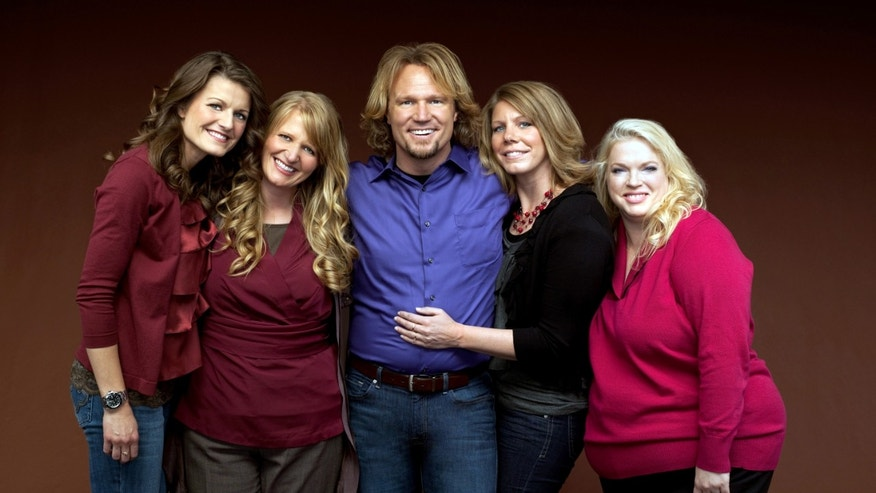"In this file publicity photo provided by TLC, Kody Brown, center, poses with his wives, from left, Robyn, Christine, Meri and Janelle, in a promotional photo for the reality series, ""Sister Wives,"" which aired in March, 2011."