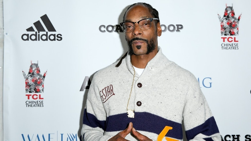 "In this May 16, 2016, file photo, Snoop Dogg arrives at the LA Premiere of ""Coach Snoop"" at the TCL Chinese 6 Theatres in Los Angeles."