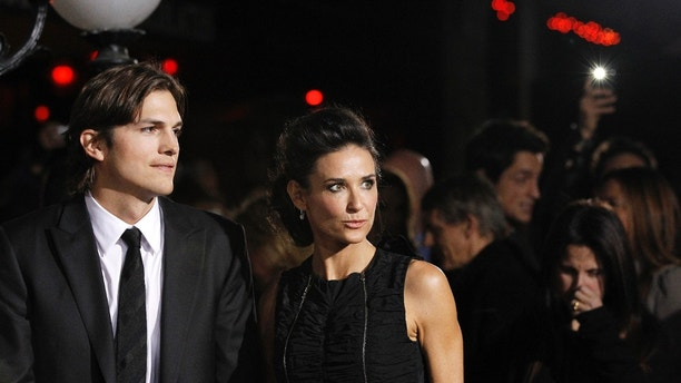 "Cast member Ashton Kutcher and his wife actress Demi Moore attend the premiere of ""No Strings Attached"" at the Regency Village theatre in Los Angeles January 11, 2011. The movie opens in the U.S. on January 21.   REUTERS/Mario Anzuoni (UNITED STATES - Tags: ENTERTAINMENT) - RTXWGKZ"