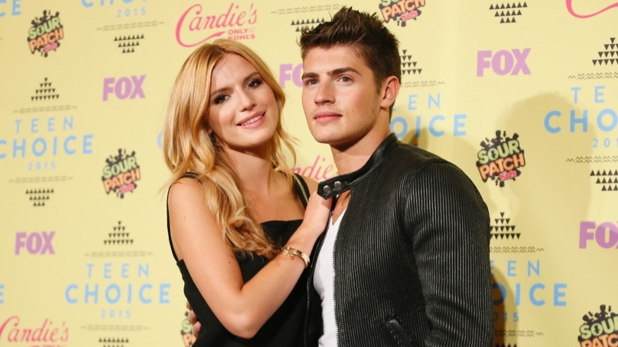 Actors Bella Thorne and Gregg Sulkin pose backstage at the 2015 Teen Choice Awards in Los Angeles, California, United States August 16, 2015.