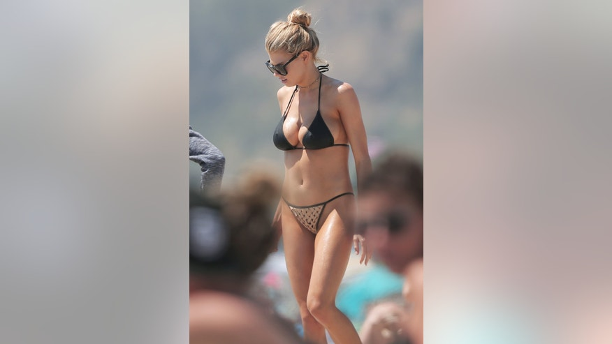 Model Charlotte McKinney displays her curves on the beach in Santa Monica.