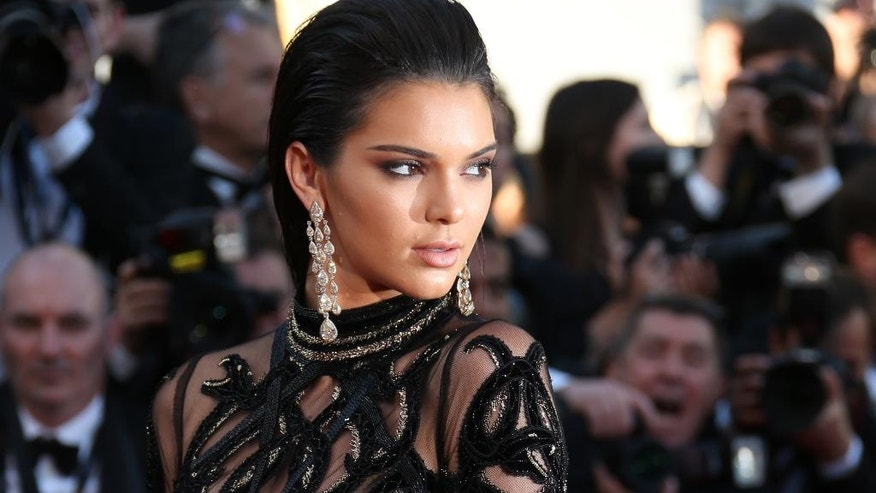In this May 15, 2016, file photo, Kendall Jenner poses for photographers upon arrival at the screening of the film Mal De Pierres at the Cannes International Film Festival in southern France.