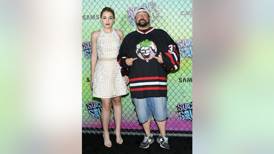"In this Aug. 1, 2016, file photo, Harley Quinn Smith, left, and her father, Kevin Smith, attend the world premiere of ""Suicide Squad"" at the Beacon Theatre in New York."
