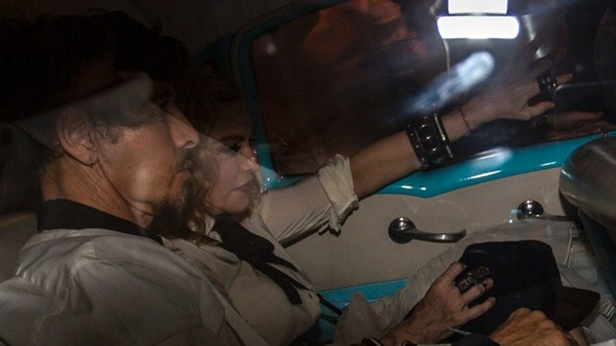 US performer Madonna rides in a classic American car on the way into a landmark private restaurant for a party in Havana, Cuba, Tuesday, Aug. 16, 2016. Madonna is on a private visit to Cuba to celebrate her 58th birthday. (AP Photo/Desmond Boylan)