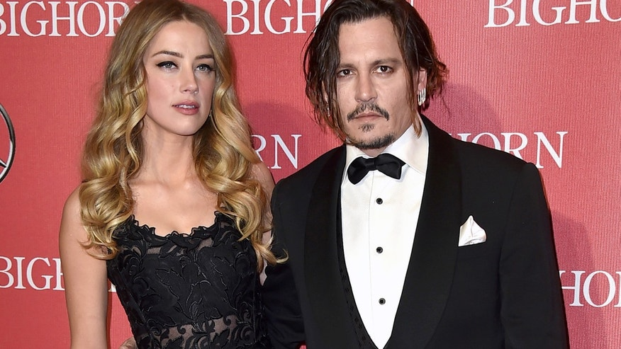 Jan. 2, 2016: Amber Heard, left, and Johnny Depp arrive at the 27th annual Palm Springs International Film Festival Awards Gala in Palm Springs, Calif.