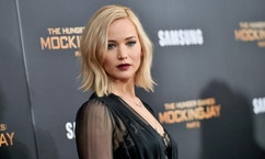 """FILE - In this Nov. 18, 2015, file photo, actress Jennifer Lawrence attends a special screening of """"The Hunger Games: Mockingjay Part 2"""" at the AMC Loews Lincoln Square in New York.  Lawrence topped Forbes magazine's list of the world's highest-paid actress, banking $46 million between June 1, 2015, and June 1, 2016, thanks to her paycheck for the final """"Hunger Games"""" installment. Lawrence out-earned second-ranked Melissa McCarthy with $33 million and Scarlett Johansson at No. 3 with $25 million.(Photo by Evan Agostini/Invision/AP, File)"""