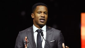 """FILE - In this April 14, 2016 file photo, Nate Parker, director of the upcoming film """"The Birth of a Nation,"""" accepts the Breakthrough Director of the Year award during the CinemaCon 2016 Big Screen Achievement Awards in Las Vegas. The American Film Institute has canceled plans to screen writer-director Nate Parker's """"The Birth of a Nation"""" for students this week amid controversies surrounding a 17 year old rape accusation of Parker and his co-writer. (Photo by Chris Pizzello/Invision/AP, File)"""