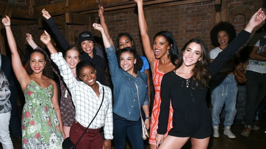 "Members of the ""Final Five"" Rio Olympics gold medal winning U.S. Gymnastics team,Madison Kocian, Simone Biles, Gabby Douglas, Laurie Hernandez, and Aly Raisman pose with ""Hamilton"" actors who play the Schuyler sisters, Jasmine Cephas Jones, Lexi Lawson and Renee Elise Goldsberry backstage after attending the performance at the Richard Rogers Theatre on Tuesday, Aug. 23, 2016, in New York. (Photo by Evan Agostini/Invision/AP)"