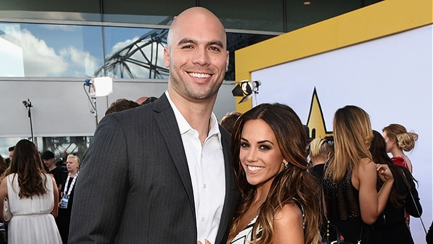 Professional football player Mike Caussin (L) and actress/singer Jana Kramer attend the 50th Academy Of Country Music Awards at AT&T Stadium on April 19, 2015 in Arlington, Texas.