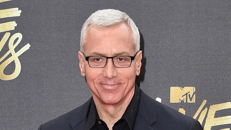 In this April 9, 2016 file photo, Drew Pinsky arrives at the MTV Movie Awards in Burbank, Calif.