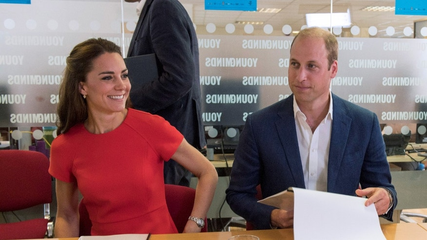 Britain's Catherine, Duchess of Cambridge, and Prince William smile during a visit to a helpline service, as part of a Heads Together campaign in London, Britain, August 25, 2016.