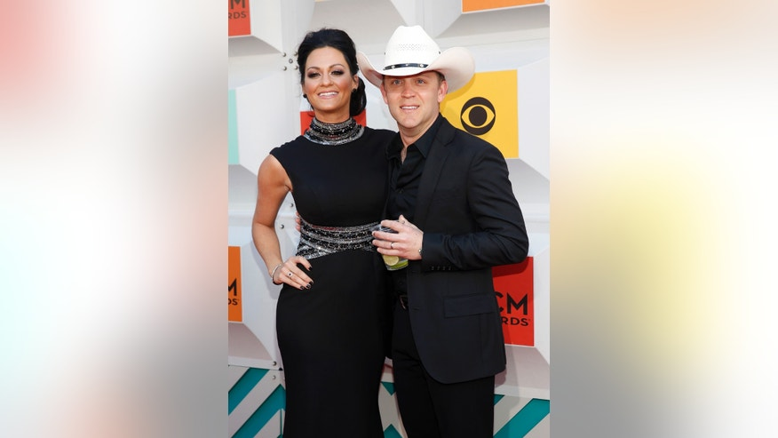 Justin Moore and his wife at the Academy of Country Music Awards in Las Vegas.