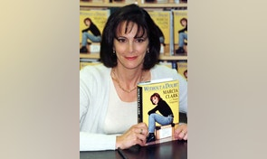 "Marcia Clark, prosecuting attorney in the O.J. Simpson double-murder trial, poses with her memoir ""Without a Doubt"" at a book signing at a Barnes & Noble bookstore in New York on May 13. The book, written with journalist Teresa Carpenter, is said to describe the day-by-day evolution of the prosecution's case in the trial. - RTXHINA"
