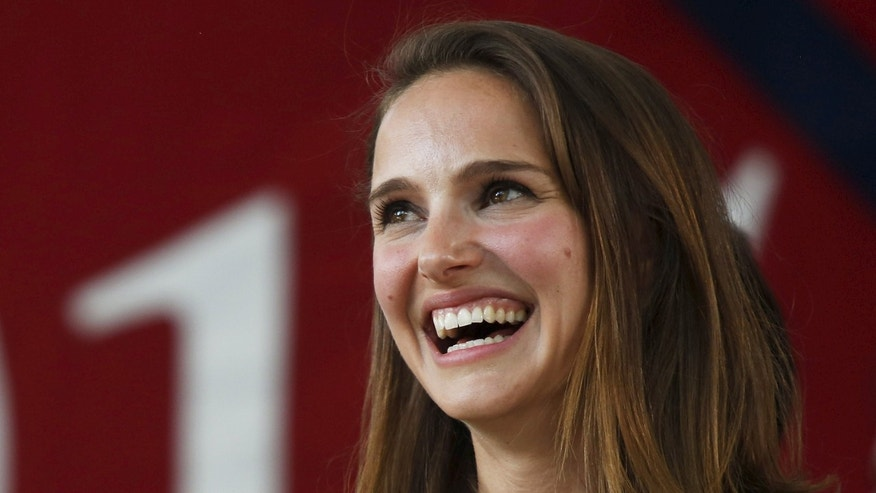 Natalie Portman is happy to be in L.A. after living in Paris.