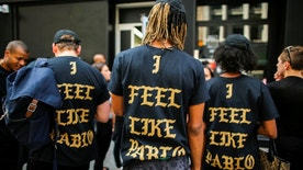 """People wear """"The life of Pablo"""" merchandise after visiting the pop up store featuring fashion by Kanye West in Manhattan, New York, U.S., August 19, 2016. REUTERS/Eduardo Munoz  - RTX2M6AE"""
