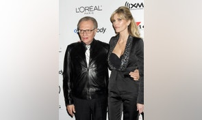 Television personality Larry King (L) and his wife Shawn Southwick arrive at a pre-Grammy party hosted by Clive Davis at the Beverly Hills Hilton in Beverly Hills, California February 7, 2006. The Grammy Awards will be presented in Los Angeles on February 8. REUTERS/Fred Prouser - RTR15Z59