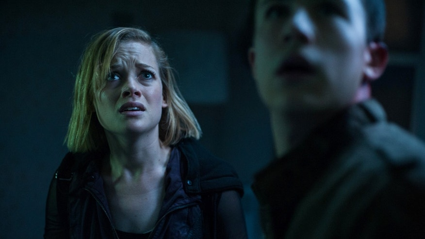 "This undated file image released by Sony Pictures shows Jane Levy, left, and Dylan Minnette in a scene from ""Dont Breathe."""