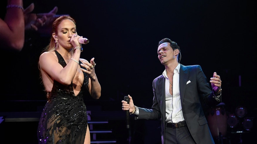 Jennifer Lopez (L) performs onstage with Marc Anthony at Radio City Music Hall on August 27, 2016 in New York City.