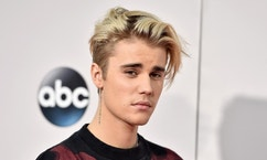 FILE - In this Nov. 22, 2015 file photo, Justin Bieber arrives at the American Music Awards at the Microsoft Theater in Los Angeles. Bieber has returned to Instagram two weeks after disappearing from the photo sharing platform after getting negative comments from fans of ex-girlfriend Selena Gomez. (Photo by Jordan Strauss/Invision/AP, File)
