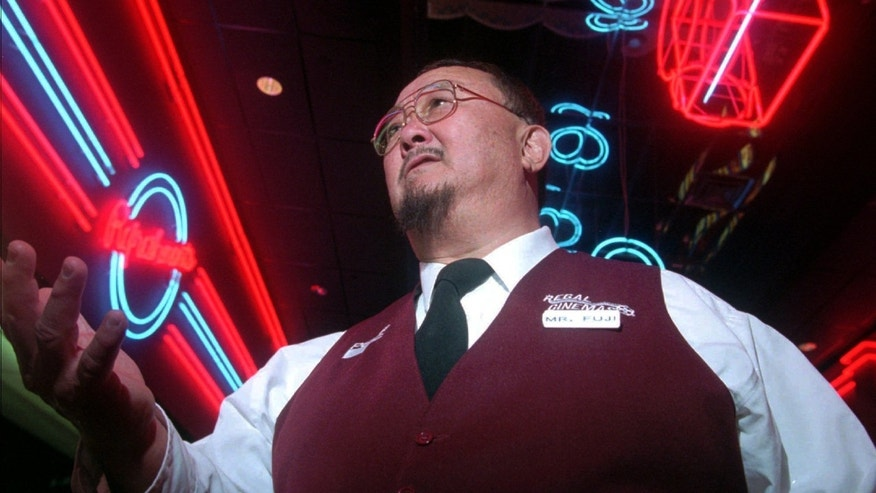 "In this April 2, 1999, file photo, Harry Fujiwara, a former wrestler known as ""Mr. Fuji,"" appears at a movie theater where he works part time as an usher in Knoxville, Tenn."