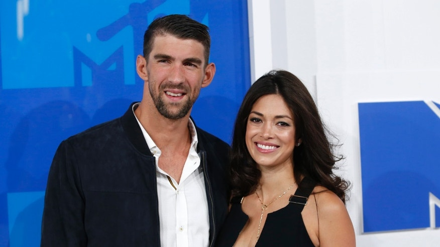 Olympic swimmer Michael Phelps and fiancee Nicole Johnson arrive at the 2016 MTV Video Music Awards in New York, U.S., August 28, 2016.